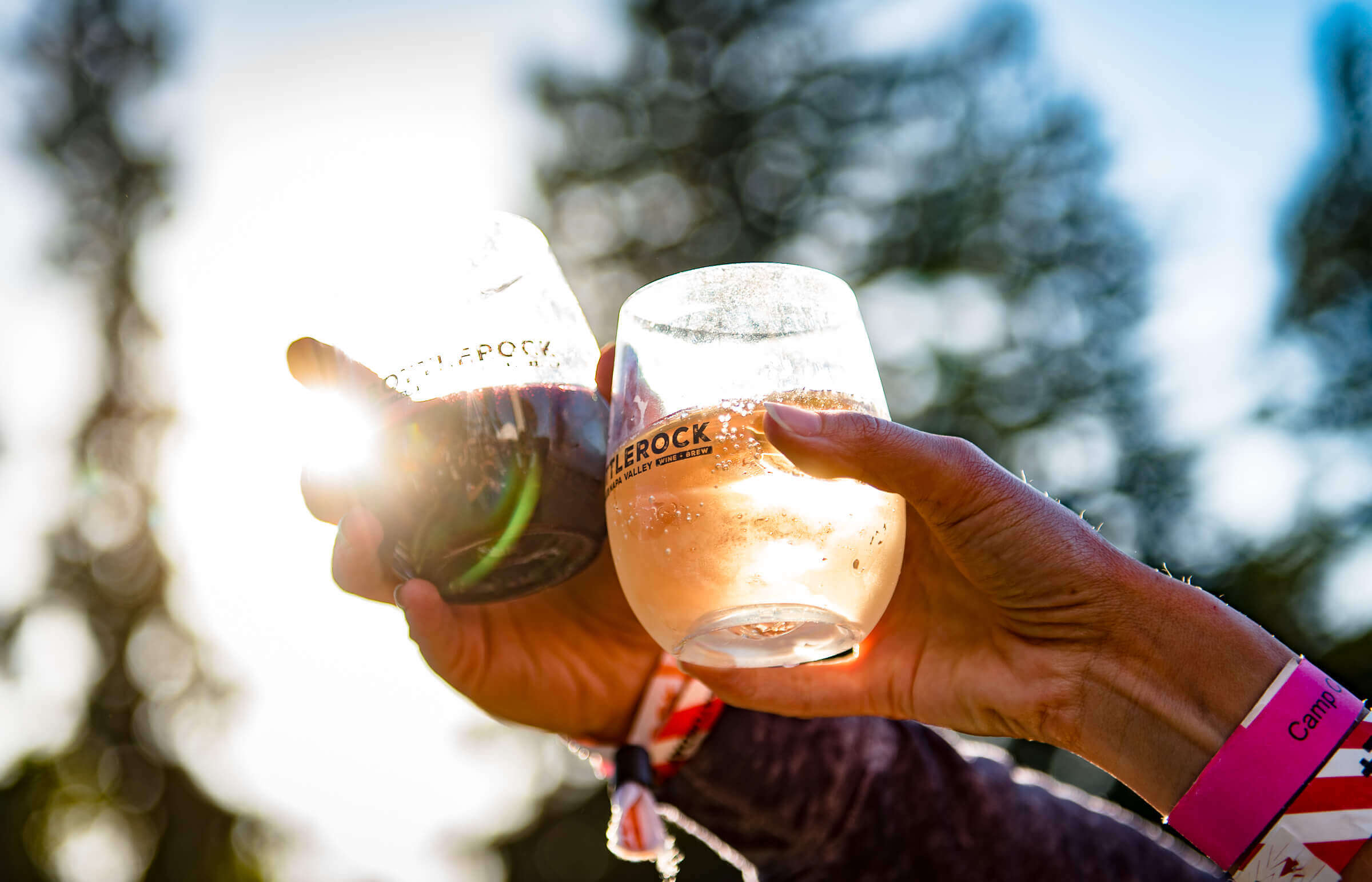 At BottleRock - two hands holding wine glasses